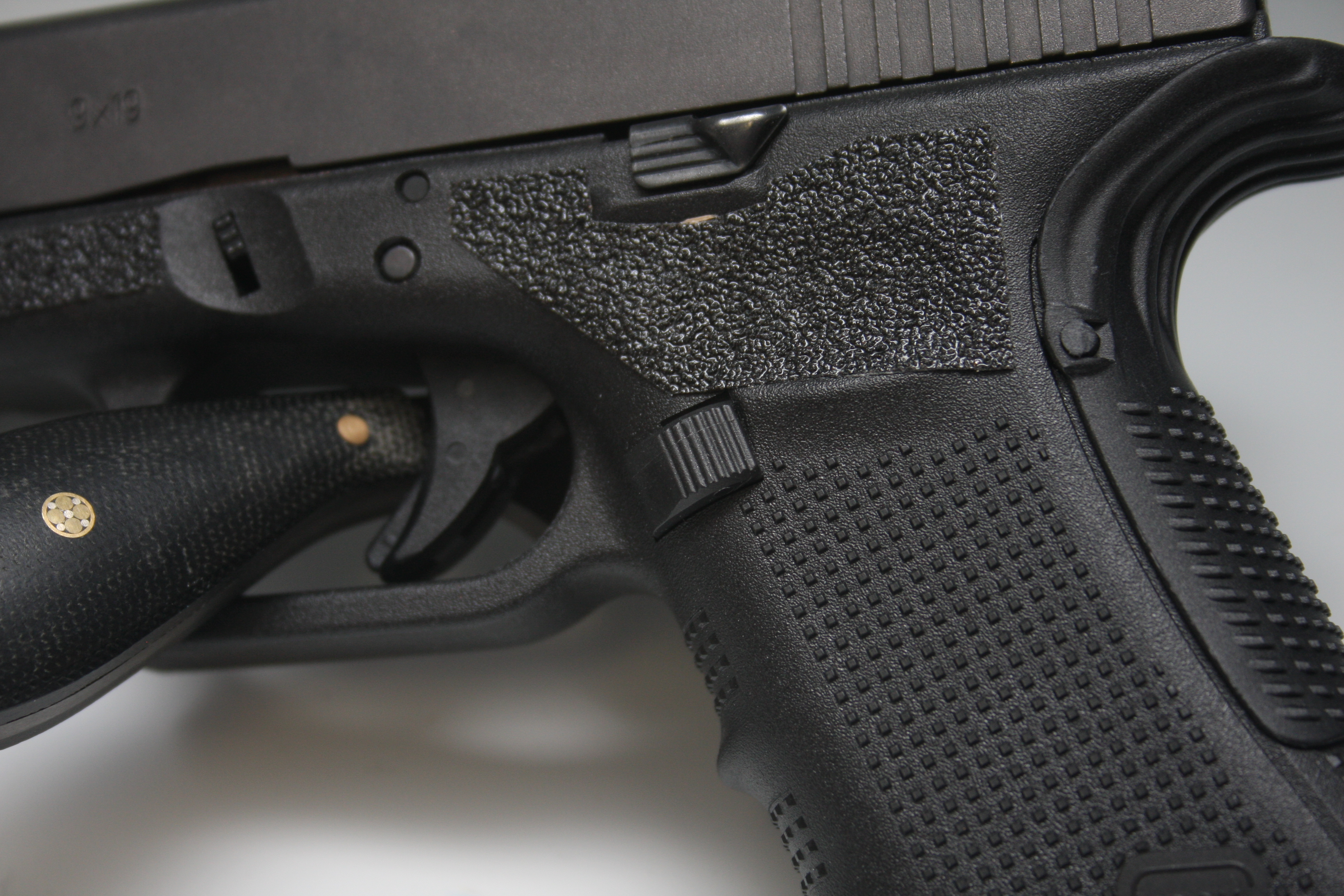 The Tango Down magazine release and the Glock extended slide release make reloading the Glock at speed a little bit easier.