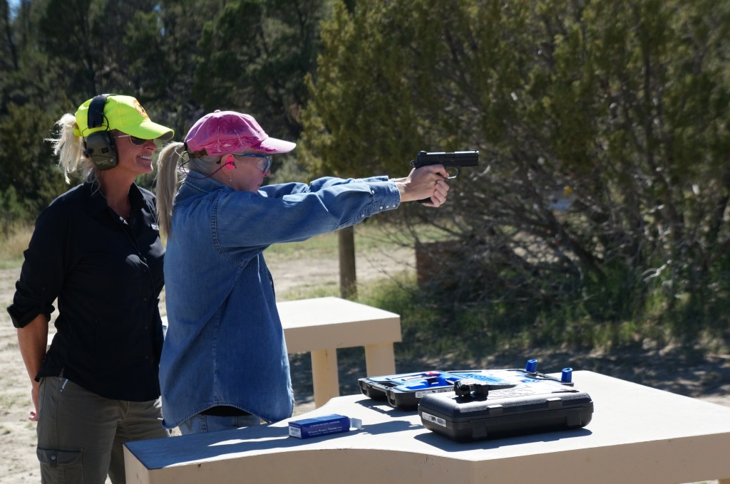 One of my group members and an instructor during the pistol portion of the Women's Wilderness Escape.