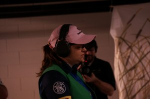 Randi taking a zen moment before shooting a stage at the 2014 IDPA Indoor Nationals
