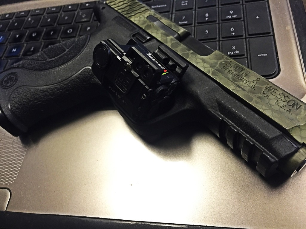 M&P9 with Viridian C5L on top