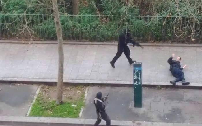 A wounded French police officer a moment before he was executed by Islamic terrorists.