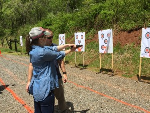 Individual attention is provided to each student to coach them through unfamiliar concepts...in this instance, teaching clearing a malfunction using dummy rounds for safety.