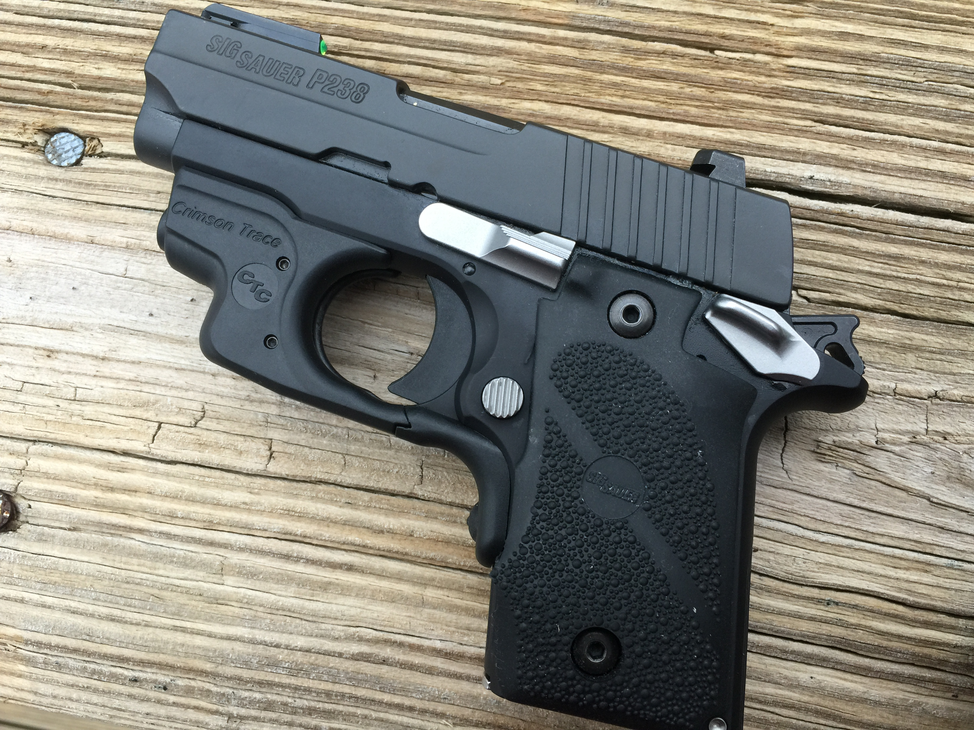 "Sig's P238 ""Sport"" shown with a Crimson Trace laser module installed on the pistol."