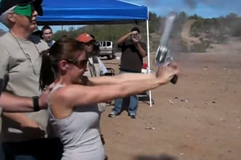 The exact moment when an inexperienced shooter accidentally fires a .500 S&W magnum into the air.  These kind of powerful firearms and fully automatic weapons should NEVER be handed to an inexperienced shooter without sensible familiarization and safety precautions. Doing so courts disaster.