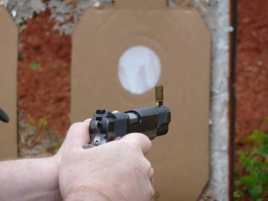 Balancing a case on the front sight magnifies any instability you introduce through an improper trigger pull.
