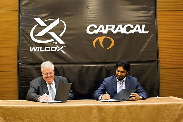 Caracal CEO Hamad Al Ameri and Wilcox Industries CEO Jim Teetzel endorse their new strategic partnership.