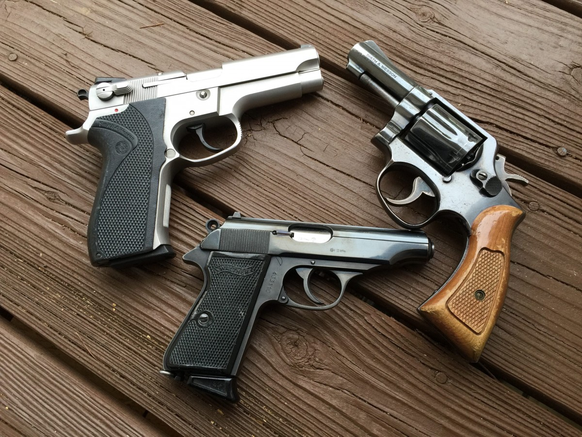 "Three police trade-in pistols: A S&W 5906, a former Australian police 3"" S&W model 10, and a former West German Police Walther PP"